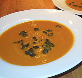 pumpkin soup with pumpkin seed garnish picture